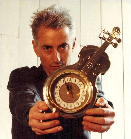 Click For Enlargement: Jon Rose with clockviolin